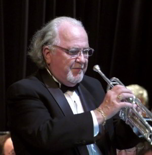 Photograph of Wayne Theriault, who will play trumpet and sing with MHJB.